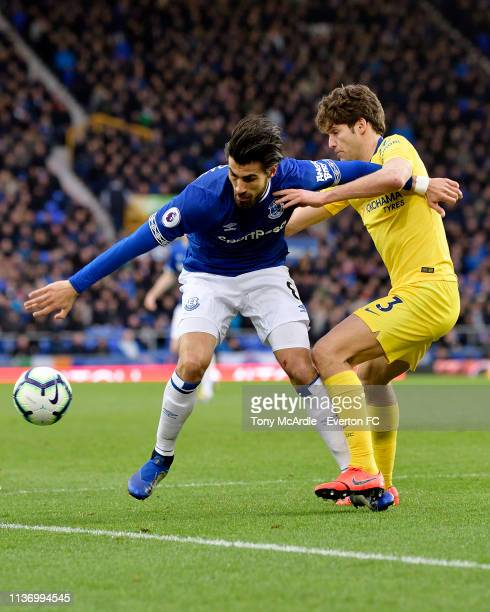Andre Gomes of Everton challenges for the ball with Marcos Alonso during the Premier League match between Everton and Chelsea at Goodison Park on...