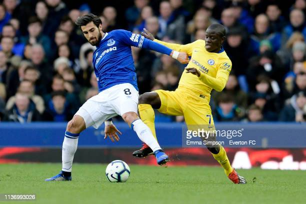 Andre Gomes of Everton challenges for the ball with Ngolo Kante during the Premier League match between Everton and Chelsea at Goodison Park on March...