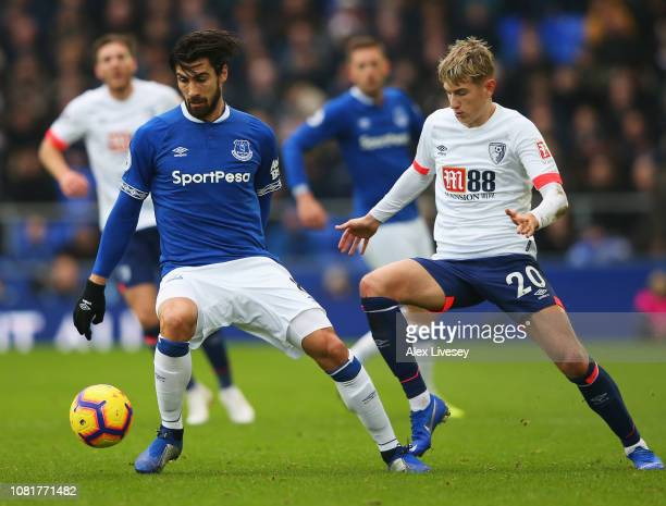 Andre Gomes of Everton evades David Brooks of AFC Bournemouth during the Premier League match between Everton FC and AFC Bournemouth at Goodison Park...