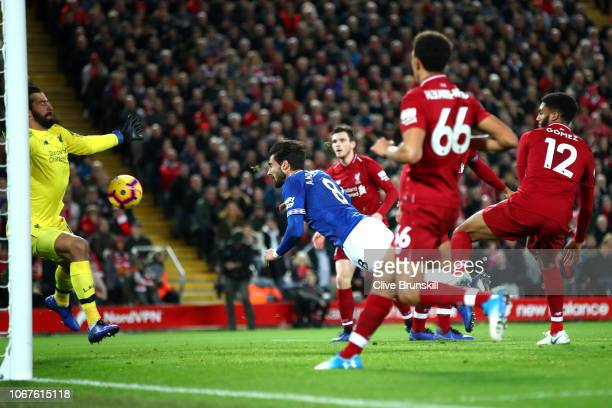 Andre Gomes of Everton has a header saved by Alisson of Liverpool during the Premier League match between Liverpool FC and Everton FC at Anfield on...