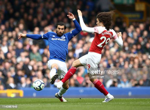 Andre Gomes of Everton is challenged by Matteo Guendouzi of Arsenal during the Premier League match between Everton FC and Arsenal FC at Goodison...