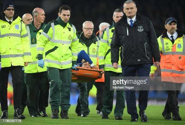 Andre Gomes of Everton is stretchered off after picking up an injury during the Premier League match between Everton FC and Tottenham Hotspur at...