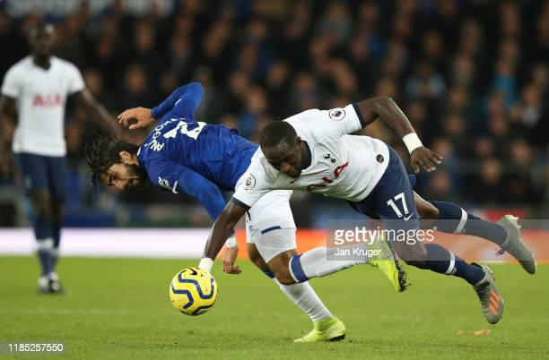 Andre Gomes of Everton is tackled by Moussa Sissoko of Tottenham Hotspur during the Premier League match between Everton FC and Tottenham Hotspur at...