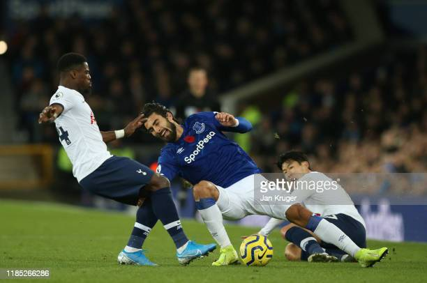 Andre Gomes of Everton is tackled by Son HeungMin of Tottenham Hotspur before colliding with Serge Aurier of Tottenham Hotspur during the Premier...