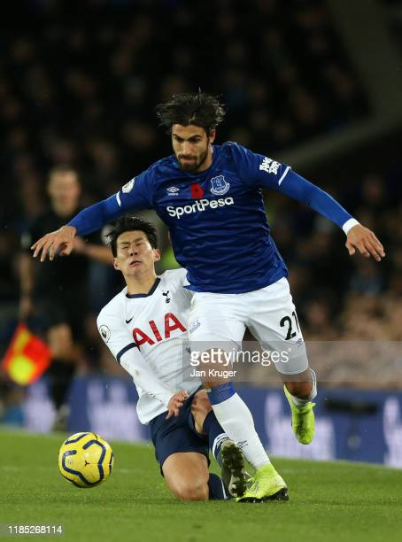 Andre Gomes of Everton is tackled by Son HeungMin of Tottenham Hotspur during the Premier League match between Everton FC and Tottenham Hotspur at...