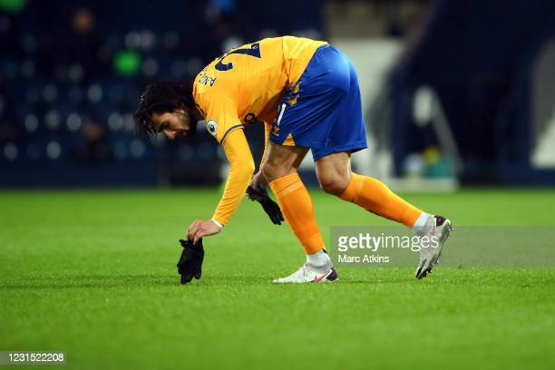 Andre Gomes of Everton picks up his gloves during the Premier League match between West Bromwich Albion and Everton at The Hawthorns on March 4, 2021...