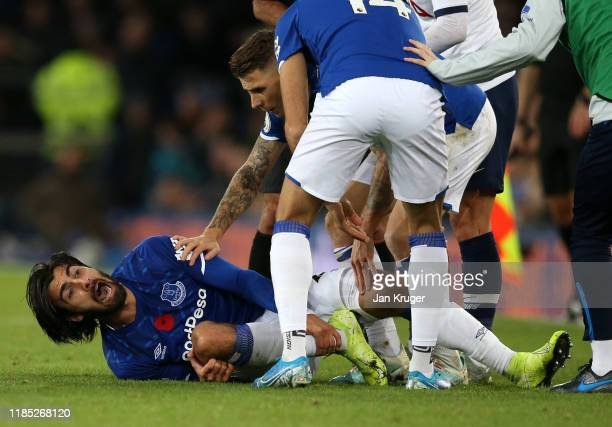 Andre Gomes of Everton reacts after being tackled by Son HeungMin of Tottenham Hotspur during the Premier League match between Everton FC and...
