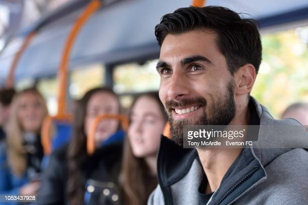 Andre Gomes of Everton rides a bus with before he surprises a young Everton fan with a trip to the club shop at Goodison Park on October 25 2018 in...