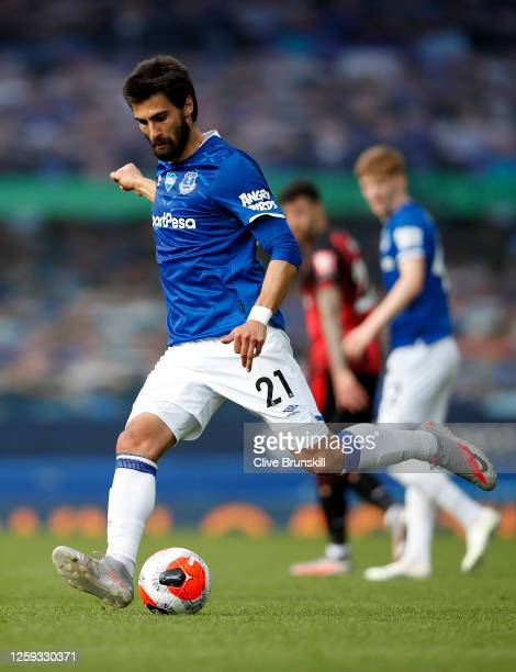 Andre Gomes of Everton runs with the ball during the Premier League match between Everton FC and AFC Bournemouth at Goodison Park on July 26 2020 in...
