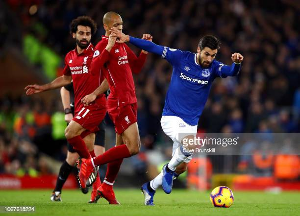 Andre Gomes of Everton runs with the ball under pressure from Fabinho of Liverpool during the Premier League match between Liverpool FC and Everton...