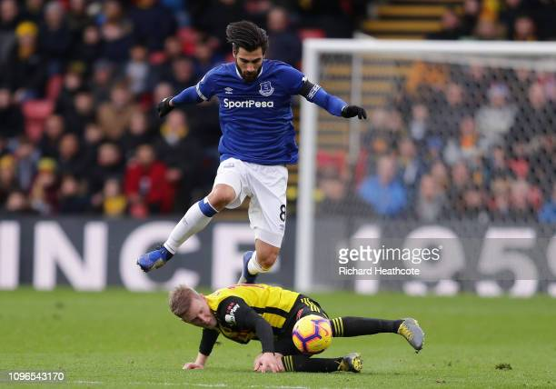 Andre Gomes of Everton skips over Will Hughes of Watford during the Premier League match between Watford FC and Everton FC at Vicarage Road on...