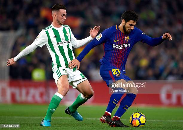 Andre Gomes of FC Barcelona being followed by Fabian Ruiz of Real Betis Balompie during the La Liga match between Real Betis and Barcelona at Estadio...