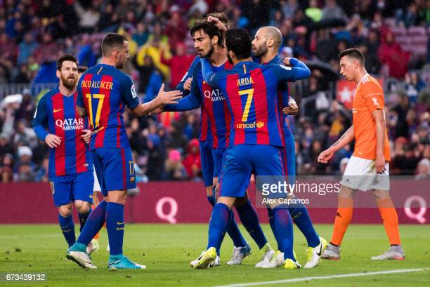 Andre Gomes of FC Barcelona celebrates with teammates after scoring his team's second goal during the La Liga match between FC Barcelona and CA...