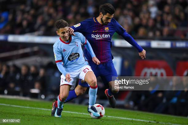 Andre Gomes of FC Barcelona competes for the ball with Emre Mor of RC Celta de Vigo during the Copa del Rey round of 16 second leg match between FC...