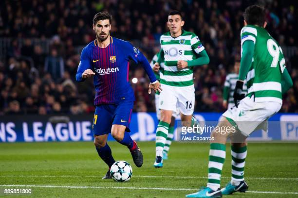 Andre Gomes of FC Barcelona conducts the ball followed by Rodrigo Battaglia of Sporting CP during the UEFA Champions League group D match between FC...