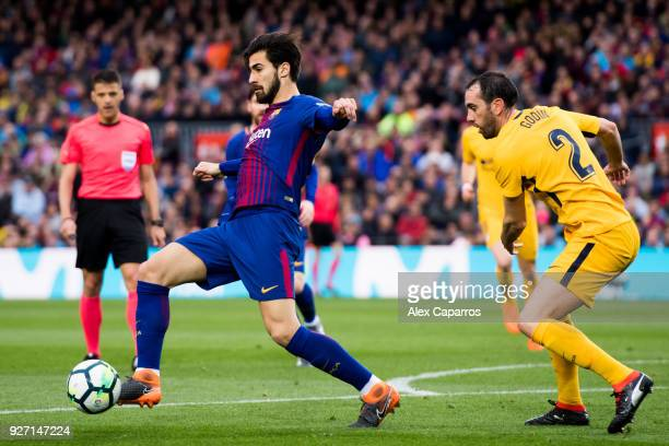 Andre Gomes of FC Barcelona controls the ball next to Diego Godin of Atletico de Madrid during the La Liga match between Barcelona and Atletico...
