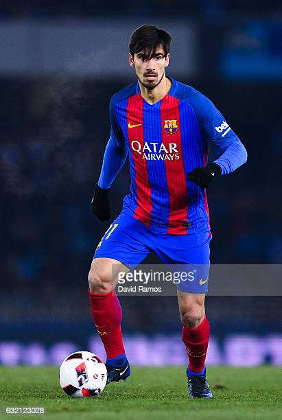 Andre Gomes of FC Barcelona runs with the ball during the Copa del Rey quarterfinal first leg match between Real Sociedad and FC Barcelona at Anoeta...