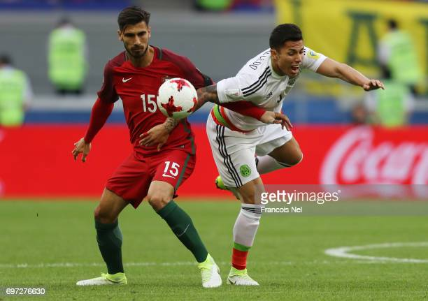 Andre Gomes of Portugal and Carlos Salcedo of Mexico battle for possession during the FIFA Confederations Cup Russia 2017 Group A match between...