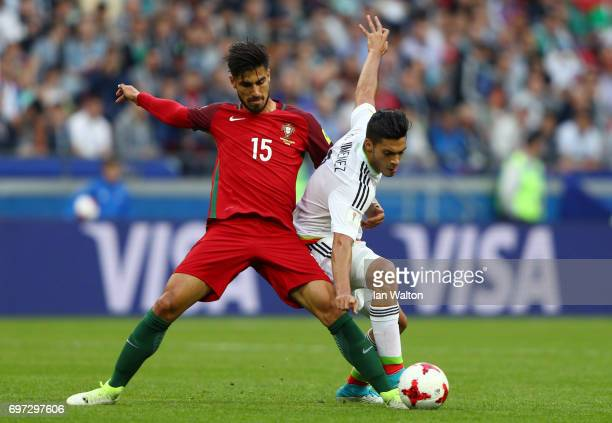 Andre Gomes of Portugal and Raul Jimenez of Mexico battle for possession during the FIFA Confederations Cup Russia 2017 Group A match between...