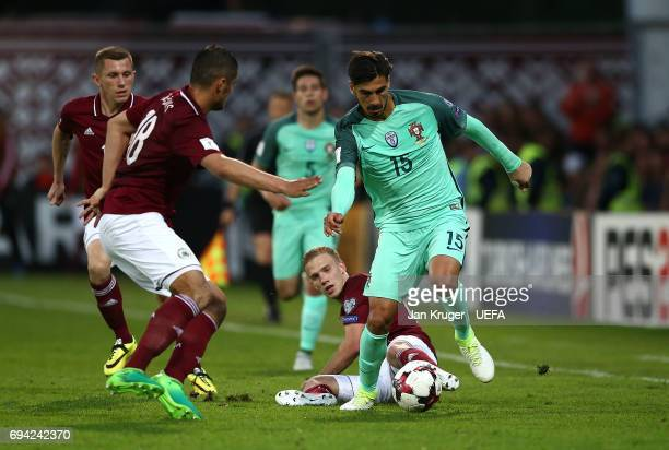 Andre Gomes of Portugal controls the ball from Glebs Kluskins of Latvia during the FIFA 2018 World Cup Qualifier between Latvia and Portugal at...