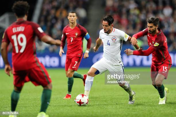 Andre Gomes of Portugal in action against Mauricio Isla of Chile during the FIFA Confederations Cup 2017 Semifinal soccer match between Portugal and...