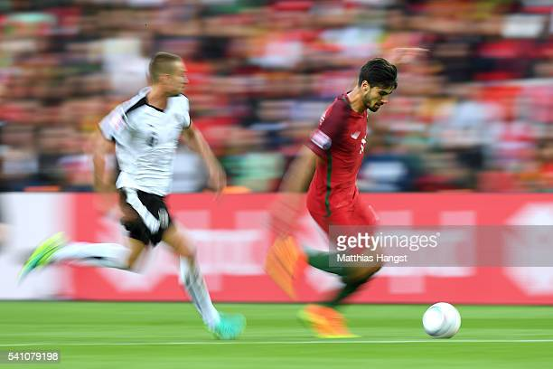 Andre Gomes of Portugal is chased by Stefan Ilsanker of Austria during the UEFA EURO 2016 Group F match between Portugal and Austria at Parc des...