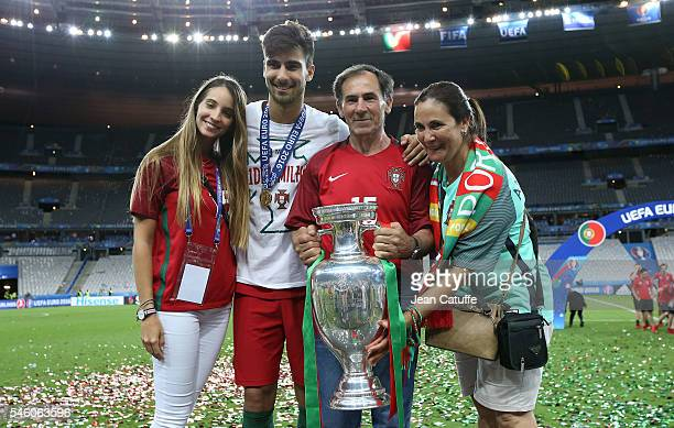 Andre Gomes of Portugal poses with the trophy following the UEFA Euro 2016 final match between Portugal and France at Stade de France on July 10 2016...