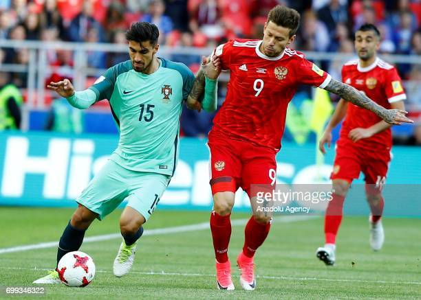 Andre Gomes of Portugal vies for the ball against Fyodor Smolov of Russia during the FIFA Confederations Cup 2017 group A football match between...