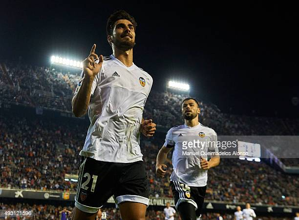 Andre Gomes of Valencia celebrates scoring his team's second goal during the La Liga match between Valencia CF and Malaga CF at Estadi de Mestalla on...