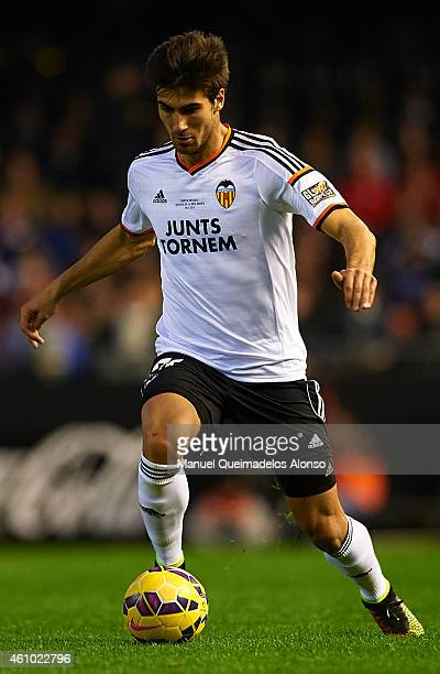 Andre Gomes of Valencia runs with the ball during the La Liga match between Valencia CF and Real Madrid CF at Estadi de Mestalla on January 4 2015 in...