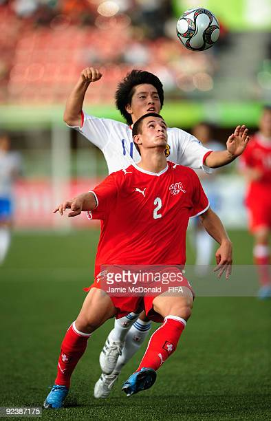 Andre Goncalves of Switzerland battles with Yoshiaki Tahagi of Japan during the FIFA U17 World Cup match between Switzerland and Japan at the Teslim...