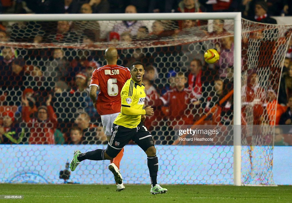 Andre Gray of Brentford celebrates scoring their second goal during the Sky Bet Championship match between Nottingham Forest and Brentford at the City Ground on November 5, 2014 in Nottingham, England.