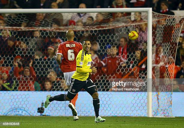 Andre Gray of Brentford celebrates scoring their second goal during the Sky Bet Championship match between Nottingham Forest and Brentford at the...