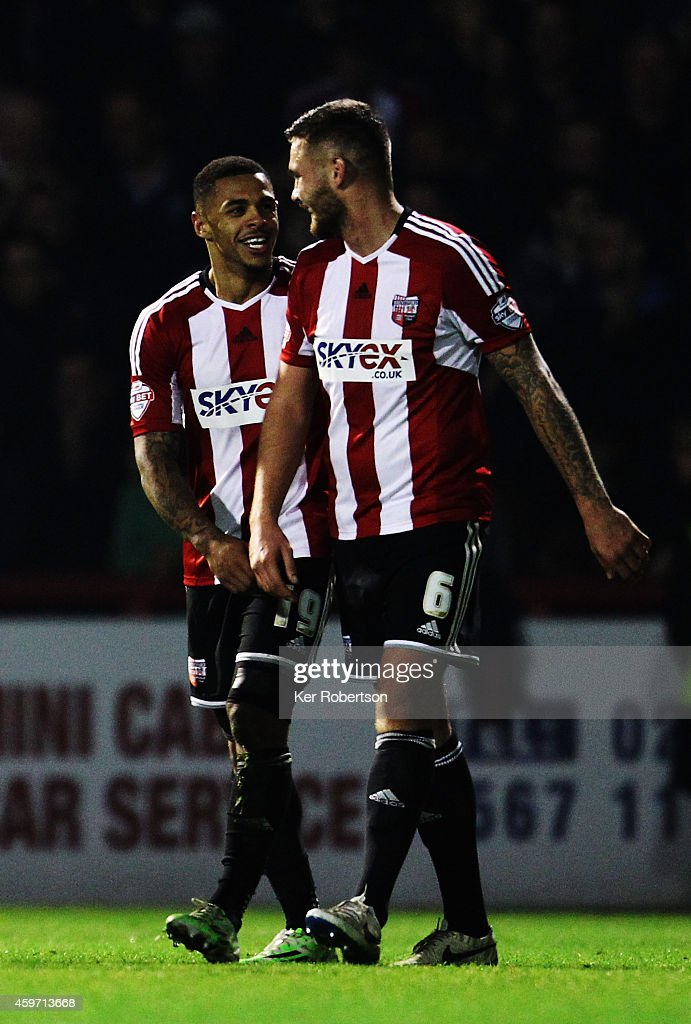 Andre Gray of Brentford celebrates with team mate Harlee Dean after scoring during the Sky Bet Championship match between Brentford and Wolverhampton Wanderers at Griffin Park on November 29, 2014 in Brentford, England.
