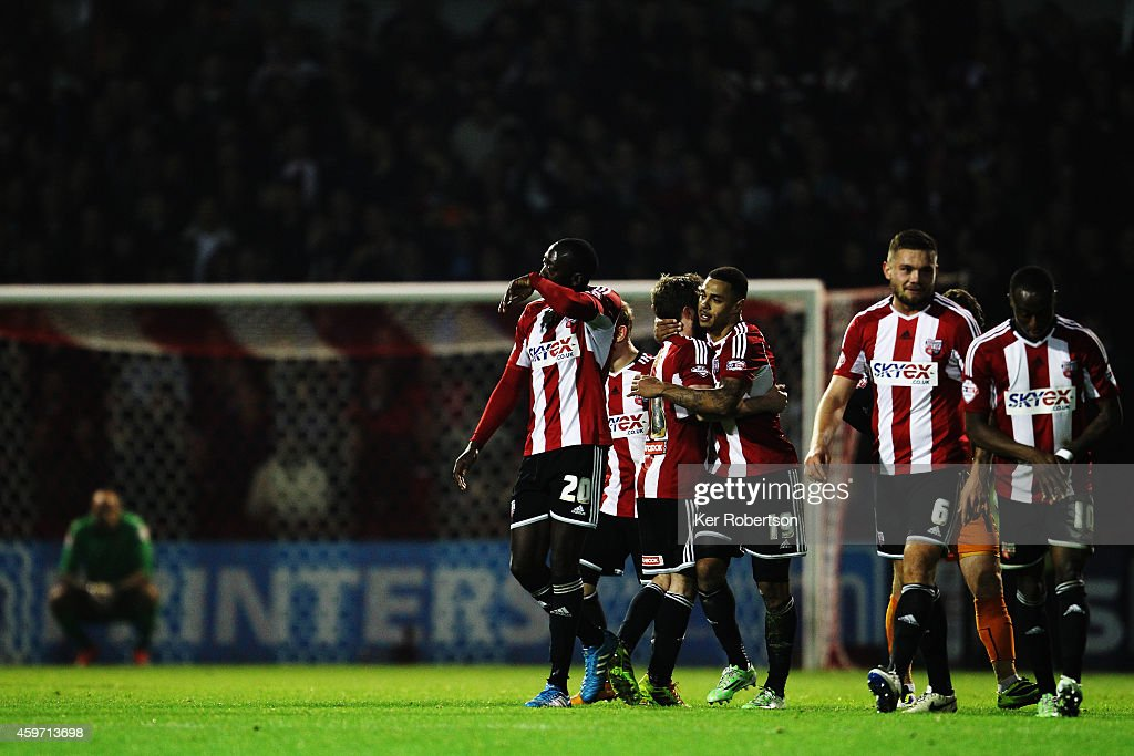 Andre Gray (#19) of Brentford celebrates with team mates after scoring during the Sky Bet Championship match between Brentford and Wolverhampton Wanderers at Griffin Park on November 29, 2014 in Brentford, England.