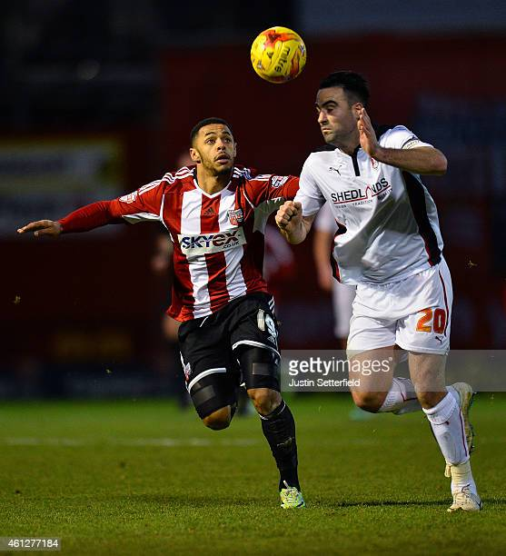Andre Gray of Brentford FC and Craig Morgan of Rotherham during the Sky Bet Championship match between Brentford and Rotherham United at Griffin Park...
