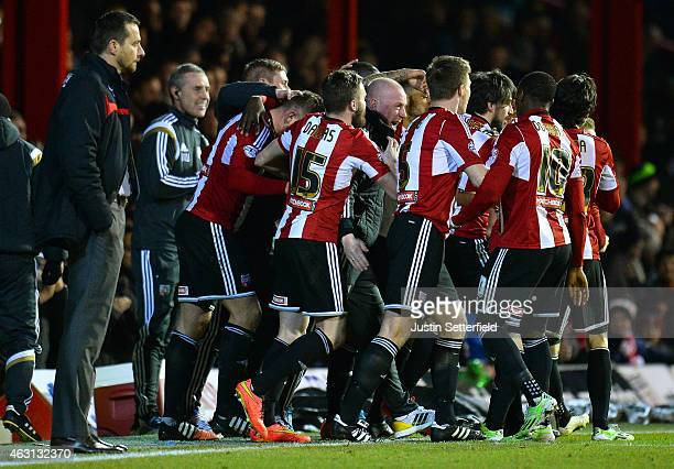 Andre Gray of Brentford FC celebrates scoring the first goal with Mark Warburton Manager of Brentford FC during the Sky Bet Championship match...