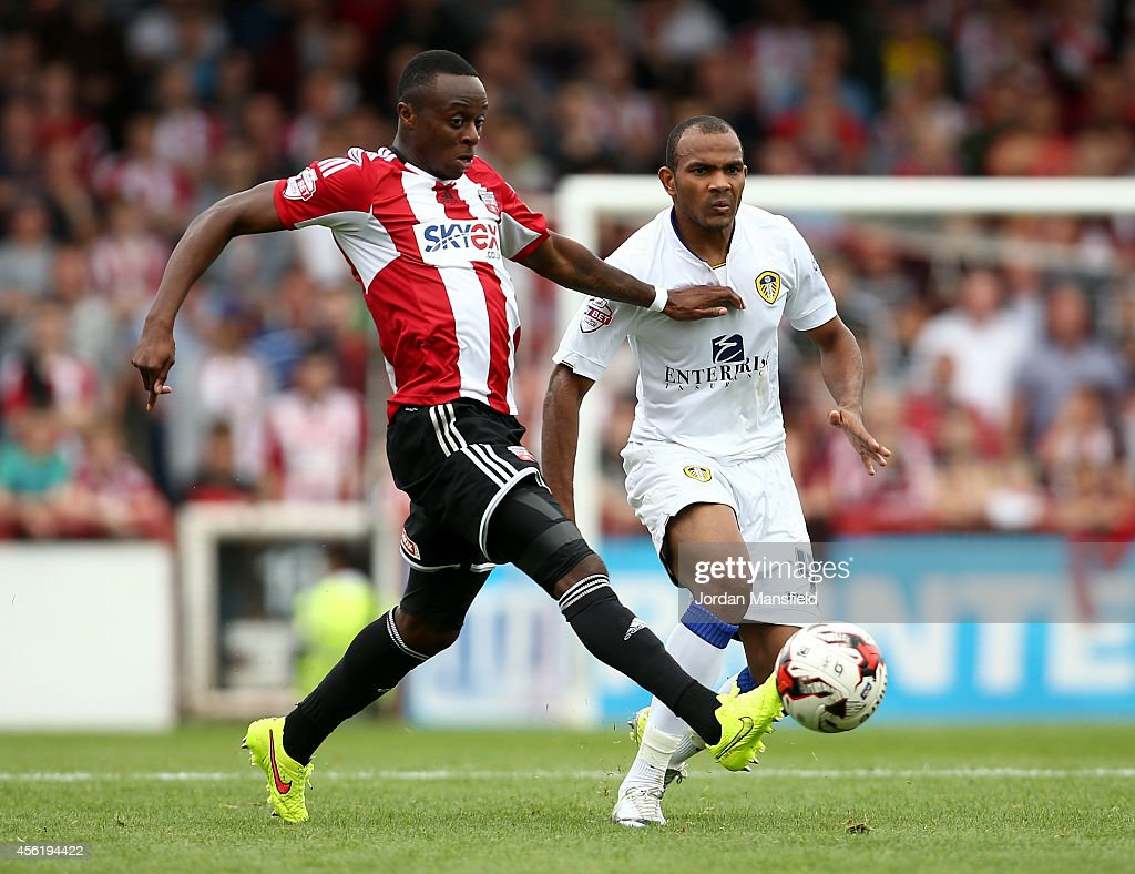 Andre Gray of Brentford tackles Rodolph Austin of Leeds during the Sky Bet Championship match between Brentford and Leeds United at Griffin Park on September 27, 2014 in Brentford, England.