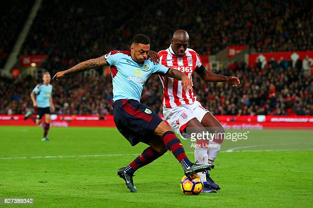 Andre Gray of Burnley and Bruno Martins Indi of Stoke City battle for the ball during the Premier League match between Stoke City and Burnley at...