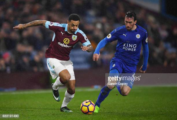 Andre Gray of Burnley and Christian Fuchs of Leicester City compete for the ball during the Premier League match between Burnley and Leicester City...