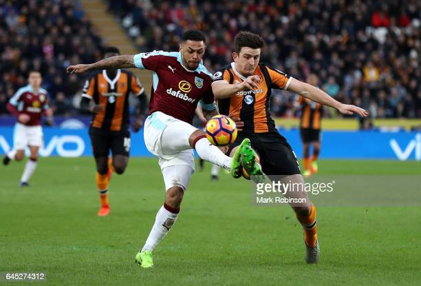 Andre Gray of Burnley and Harry Maguire of Hull City battle for possession during the Premier League match between Hull City and Burnley at KCOM...