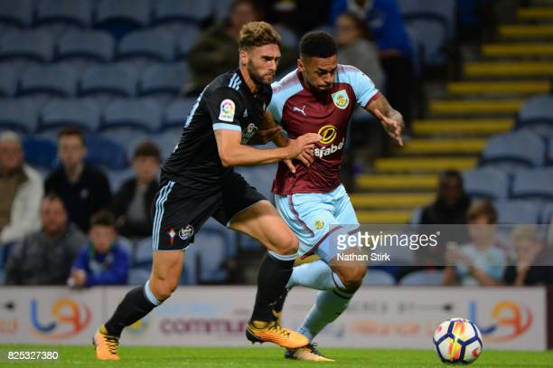 Andre Gray of Burnley and Sergi Gomez of Celta Vigo in action during the preseason friendly match between Burnley and Celta Vigo at Turf Moor on...