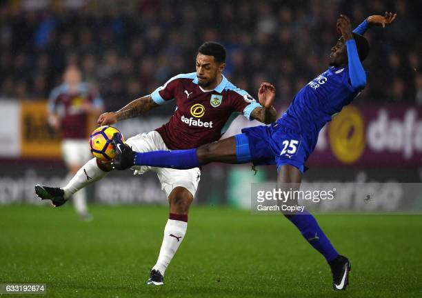 Andre Gray of Burnley and Wilfred Ndidi of Leicester City compete for the ball during the Premier League match between Burnley and Leicester City at...