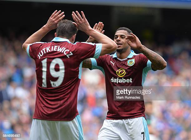 Andre Gray of Burnley celebrates after scoring his third goal of the game with team mate Lukas Jutkiewicz during a preseason friendly between Rangers...