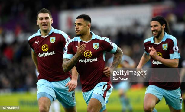Andre Gray of Burnley celebrates scoring his sides first goal during the Premier League match between Swansea City and Burnley at Liberty Stadium on...