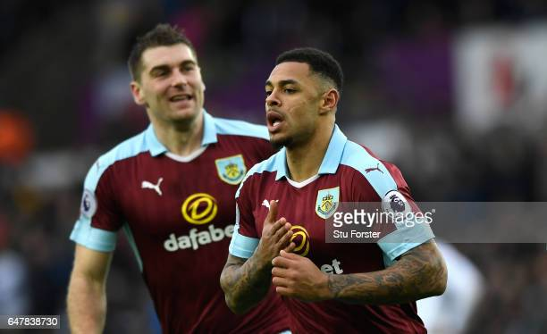 Andre Gray of Burnley celebrates scoring his sides second goal during the Premier League match between Swansea City and Burnley at Liberty Stadium on...