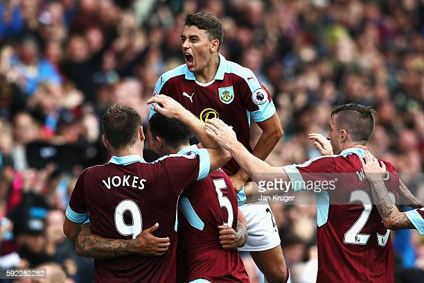 Andre Gray of Burnley celebrates scoring his sides second goal with his Burnley team mates during the Premier League match between Burnley and...