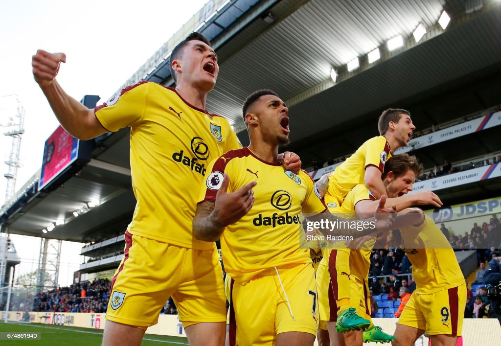 Andre Gray of Burnley celebrates scoring his team's second goal with Michael Keane (L) during the Premier League match between Crystal Palace and Burnley at Selhurst Park on April 29, 2017 in London, England.
