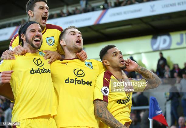 Andre Gray of Burnley celebrates scoring his team's second goal with Sam Vokes George Boyd and Matthew Lowton of Burnley during the Premier League...