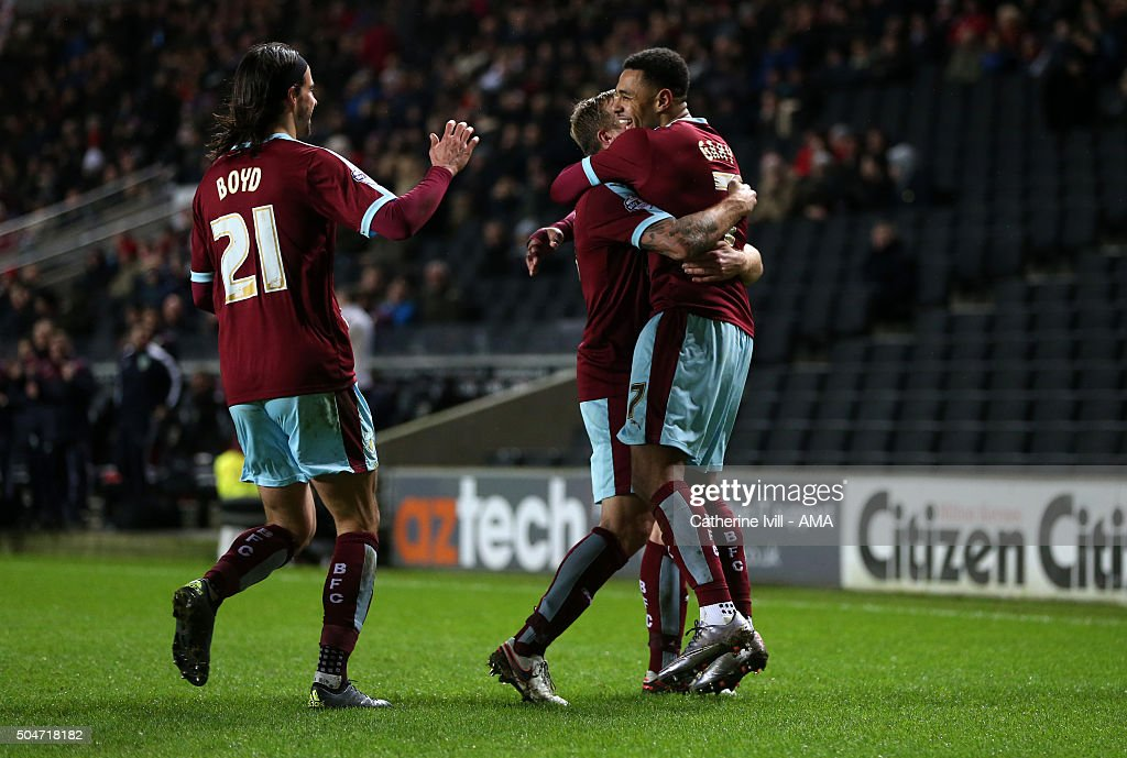Andre Gray of Burnley celebrates with his team mates after scoring to make it 0-3 during the Sky Bet Championship match between MK Dons and Burnley at Stadium mk on January 12, 2016 in Milton Keynes, England.